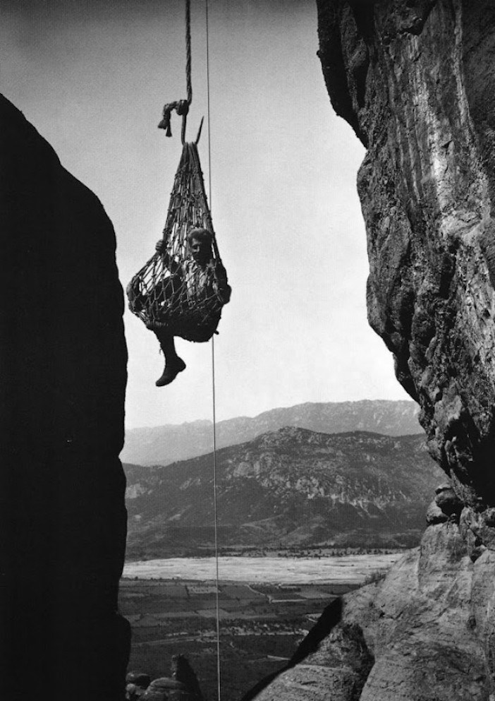 Meteora 1908. The photographer being hoisted up to a monastery.