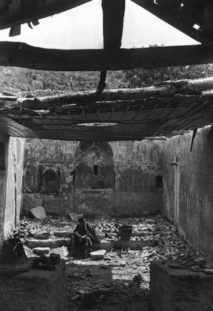 A priest in a destroyed church in Kastri, Preveza,