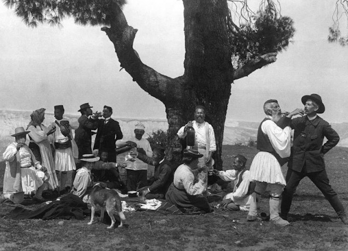 The photographer and his companion, Daniel Baud-Bovy, celebrate with loca;s in Zemeno, Corinth, 1903.