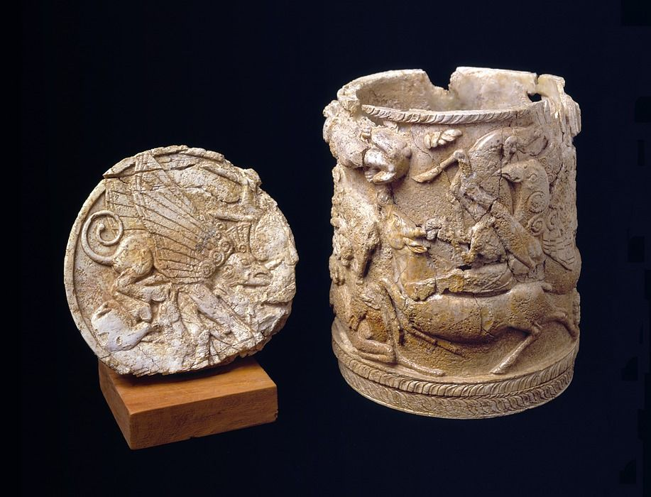 Carved ivory pyxis. Mycenaean chamber